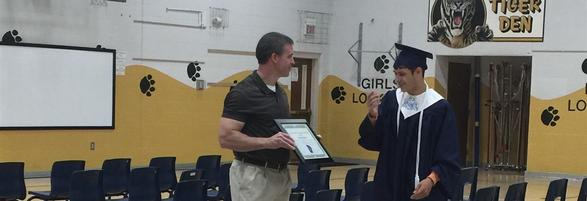 LCHS senior, Joey Dilliha, presents Auburn principal David Ward with a certificate of appreciation for all the support given to 2017 graduates during their years at Auburn Elementary.